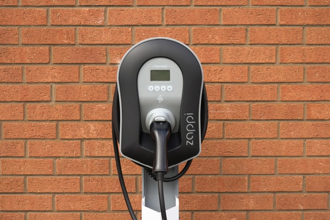 Brick wall with electric vehicle charging