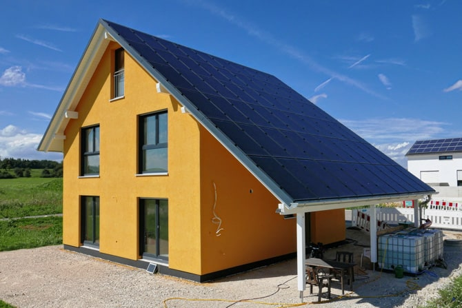 Yellow House with Solar Roof